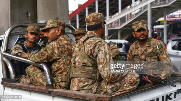 Pakistani soldiers sit on a truck during a patrol on a street in Rawalpindi on July 23 2018 Pakistan will hold the general election on July 25