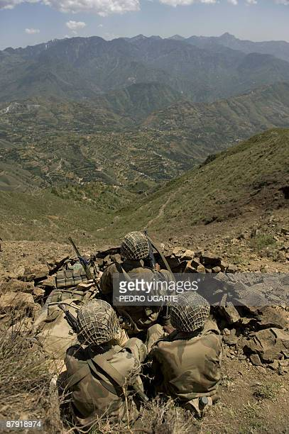 Pakistani soldiers sit on top of a mountain at Banai Baba Ziarat area in northwest Pakistan on May 22 2009 The army took control of the mountain used...