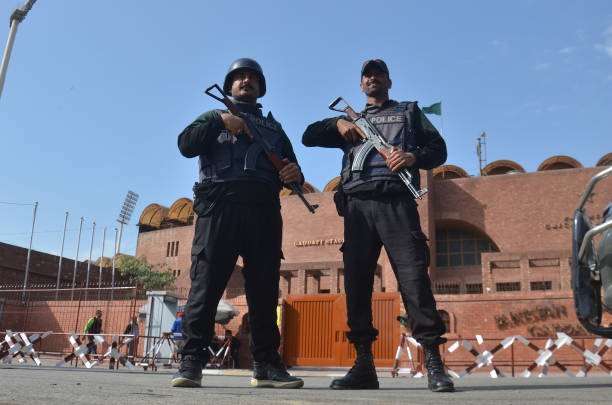 Pakistani soldiers stand alert outside the Qaddafi Stadium ahead of the cricket Pakistan Super League final Pakistan Cricket Board and officials of...
