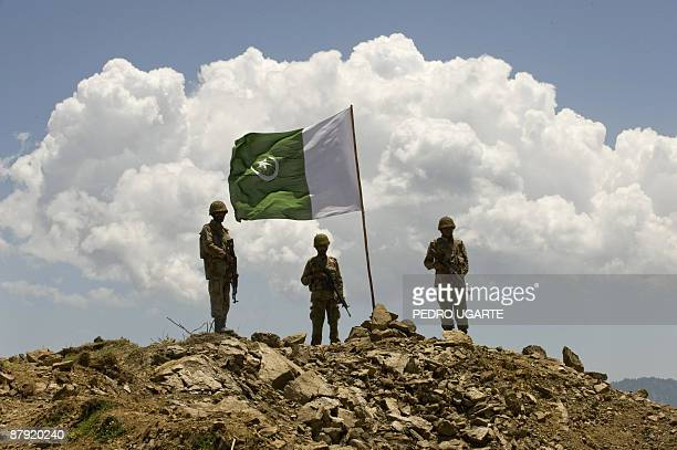 Pakistani soldiers stand guard on top of a mountain at Banai Baba Ziarat area in northwest Pakistan on May 22 2009 The army took control of the...