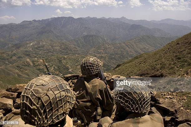 Pakistani soldiers stand guard on top of a mountain overlooking the Swat valley at Banai Baba Ziarat area on May 22 2009 in northwest Pakistan The...