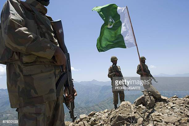 Pakistani soldiers stand guard on top of a mountain overlooking the Swat valley at Banai Baba Ziarat area in northwest Pakistan on May 22 2009 The...