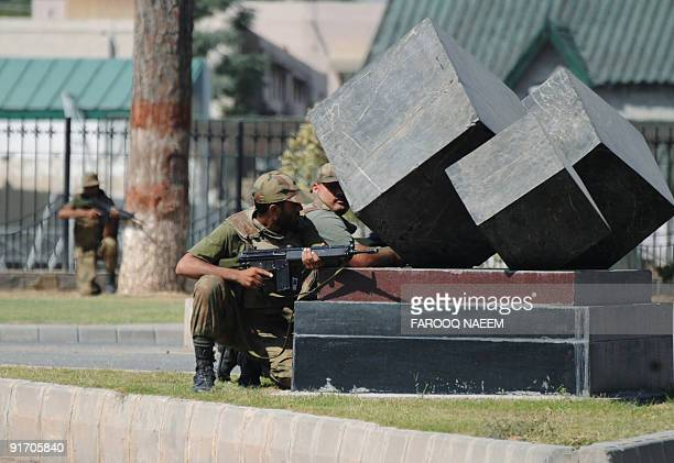 Pakistani soldiers take up position after an attack on the entrance of army headquarters in the garrison city Rawalpindi on October 10 2009 An attack...