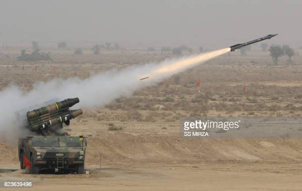 Pakistani soldiers use multibarrel rocket launchers to hit their targets during a military exercise at a trategic area along the border with India in...
