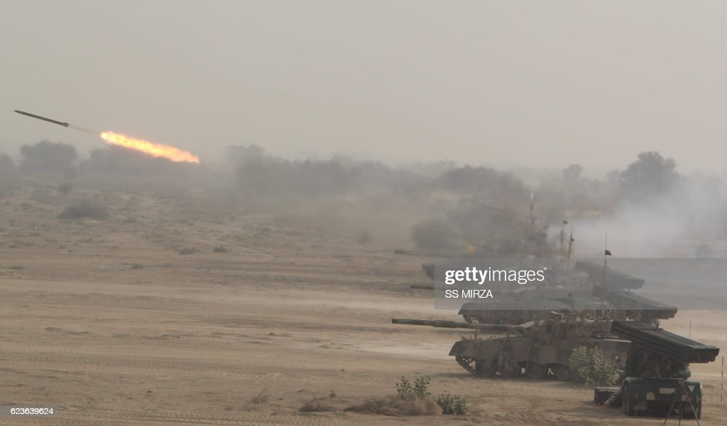 Pakistani soldiers use multibarrel rocket launchers to hit their targets during a military exercise at a trategic area along the border with India in.