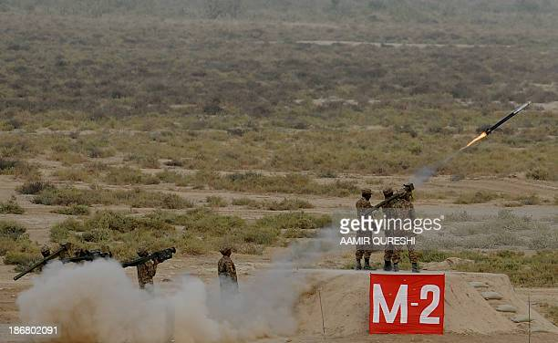 "Pakistani soldiers use rocket launchers on November 4, 2013 during in the Azm-e-Nau-4"" military exercise in Khairpure Tamay Wali in Bahawalpur..."