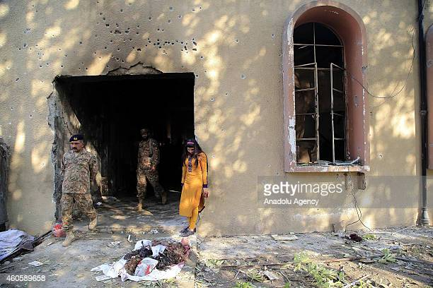 Pakistani soldiers walk in the debris of the armyrun school that was attacked by Taliban on Tuesday in northwestern city of Peshawar Pakistan on...