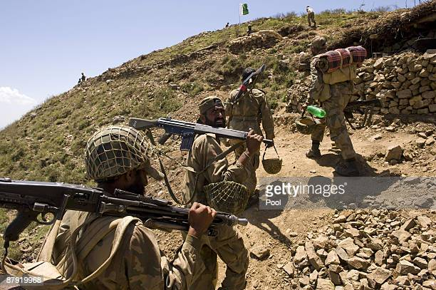 Pakistani soldiers walk to their positions on top of a mountain at Banai Baba Ziarat area on May 22 2009 in northwest Pakistan Troops took control of...