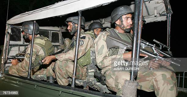 Pakistani special army commandos guard the suspected suicide blast site in Tarbela Ghazi about 70 kilometres north-west of Islamabad, 14 September...