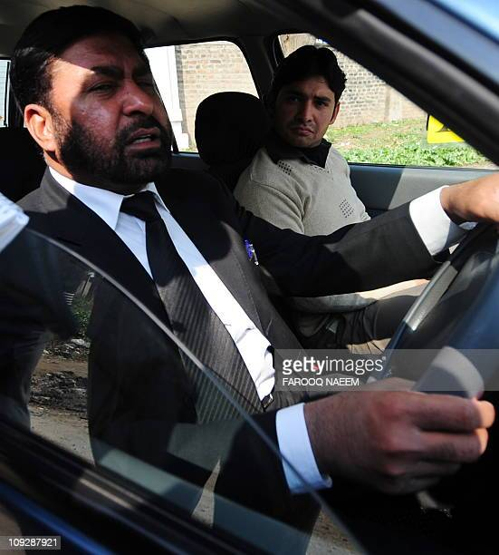 Pakistani special prosecutor Chaudhry Zulfiqar Ali drives his car as he leaves the Adiala prison in Rawalpindi on February 19 2011 A Pakistani...