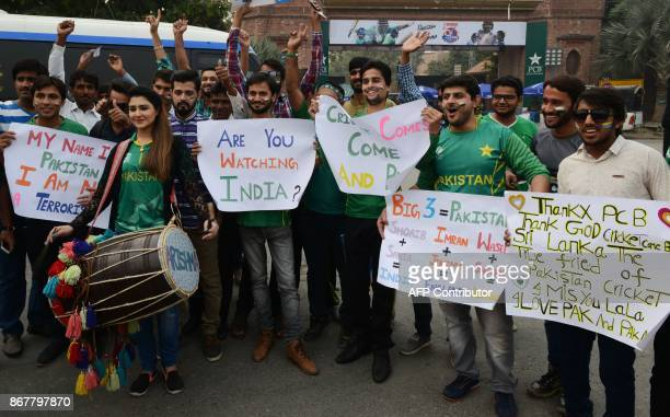 Pakistani spectator cheers prior to the start of the T20 cricket match playing between Pakistan and Sri Lanka at the Gaddafi Cricket Stadium in...