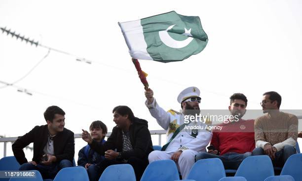 Pakistani spectator holds a Pakistani flag during the the first day of the play of 1st Test cricket match between Pakistan and Sri Lanka at Pindi...