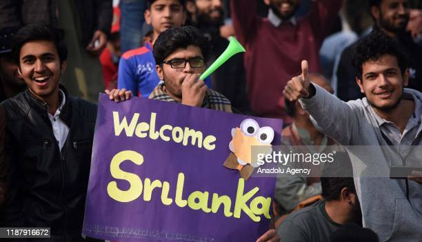 Pakistani spectators cheer as they watch the first day of the play of 1st Test cricket match between Pakistan and Sri Lanka at Pindi Cricket Stadium...