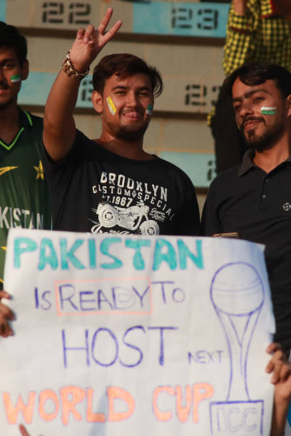 Pakistani spectators hold placards cheering the players as they watching the final match of independence cup 2017 Twenty20 international match played.