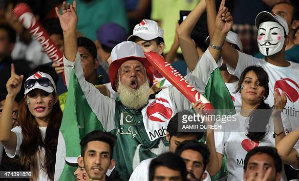 Pakistani spectators watch the first International T20 cricket match between Pakistan and Zimbabwe at the Gaddafi Cricket Stadium in Lahore on May 22...
