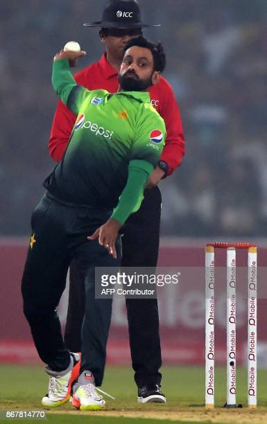 Pakistani spinner Mohammad Hafeez delivers a ball during the third and final T20 cricket match between Pakistan and Sri Lanka at the Gaddafi Cricket...