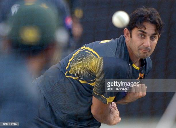 Pakistani spinner Saeed Ajmal delivers a ball during a training session in Duabi stadium on November 3 2013 Pakistan will face South Africa in the...