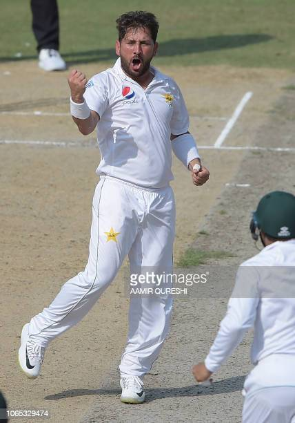 Pakistani spinner Yasir Shah celebrates after taking the wicket of New Zealand batsman Neil Wagner during the third day of the second Test cricket...