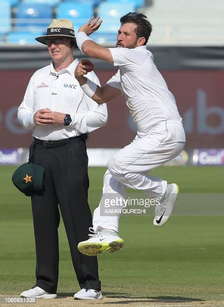 Pakistani spinner Yasir Shah delivers the ball during the fourth day of the second Test cricket match between Pakistan and New Zealand at the Dubai...
