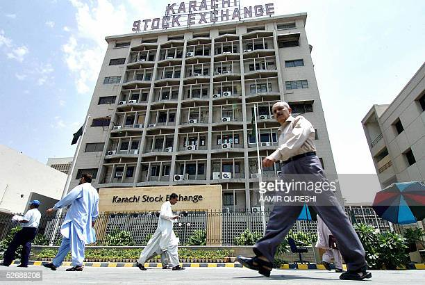 Pakistani stock brokers walk past the Karachi Stock Exchange building in Karachi 23 April 2005 Last month the KSE shed a third of its value in three...
