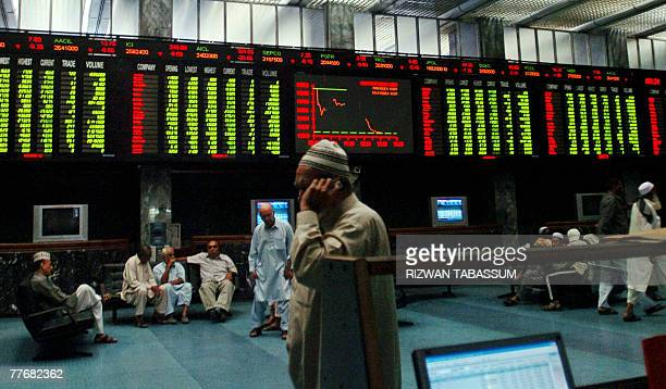 Pakistani stock brokers watch the boards during a trading session at the Karachi Stock Exchange in Karachi 05 November 2007 The KSE 100Index fell by...