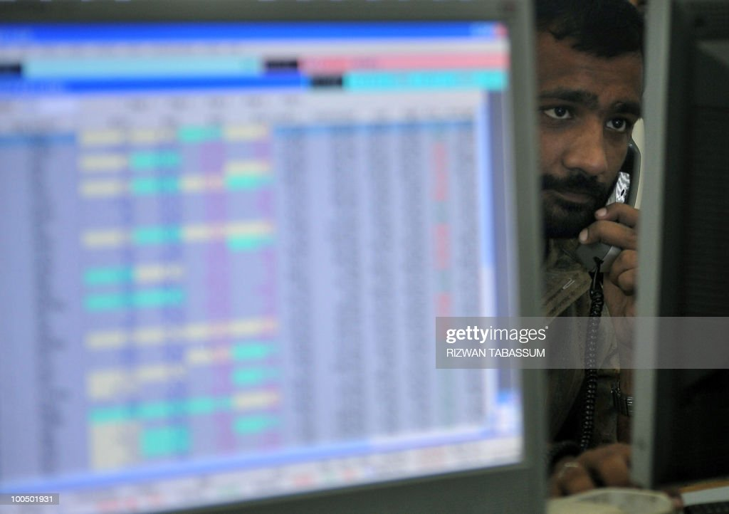 A Pakistani stockbroker speaks on the telephone while monitoring share prices at a brokerage house in Karachi on May 25, 2010. The benchmark Karachi Stock Exchange (KSE) 100 index was 9614.56, down 72.85 in the morning session. Global stocks plunged and the euro fell close to a four-year dollar low as investors fled in the face of concerns about the eurozone and tensions between North Korea and South Korea. Markets, rocked by fresh turmoil in the Spanish banking sector, were also hit by the prospect of severe austerity measures in the eurozone that could slam the brakes on the fragile global economic recovery. AFP PHOTO/Rizwan TABASSUM