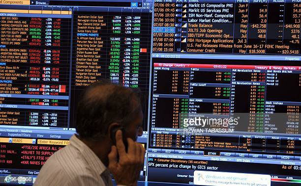 A Pakistani stockbroker watches share prices on a monitor during a trading session at the Karachi Stock Exchange in Karachi on July 6 2015 The...