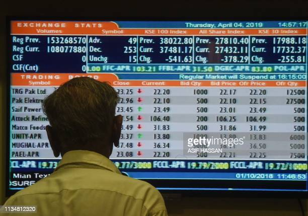 A Pakistani stockbroker watches the latest share prices during a trading session at the Pakistan Stock Exchange in Karachi on April 4 2019