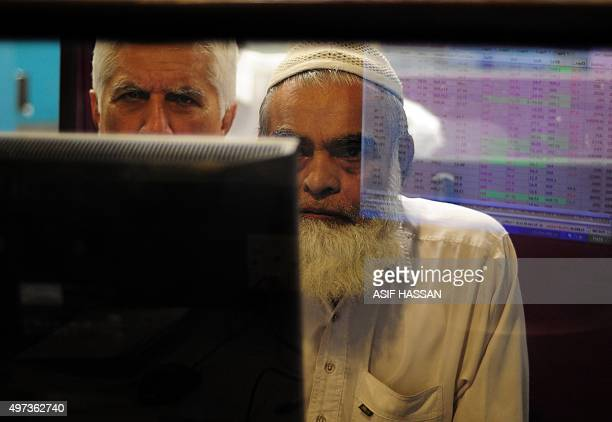 Pakistani stockbrokers monitor the latest share prices during trading at the Karachi Stock Exchange in Karachi on November 16 2015 Asian markets...
