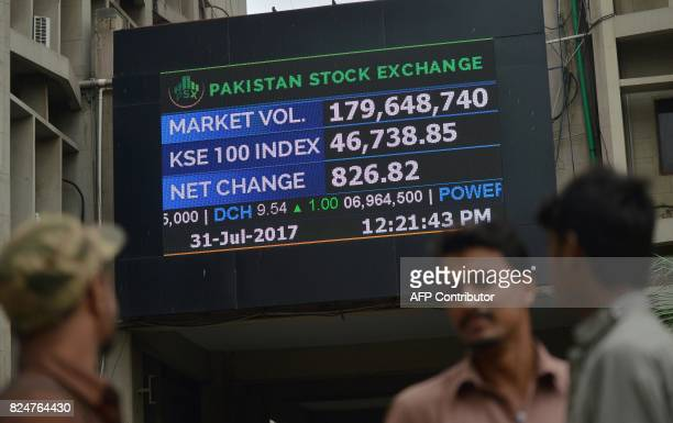 Pakistani stockbrokers watch the latest share prices at the Pakistan Stock Exchange in Karachi on July 31 2017 The benchmark PSX100 index was up...