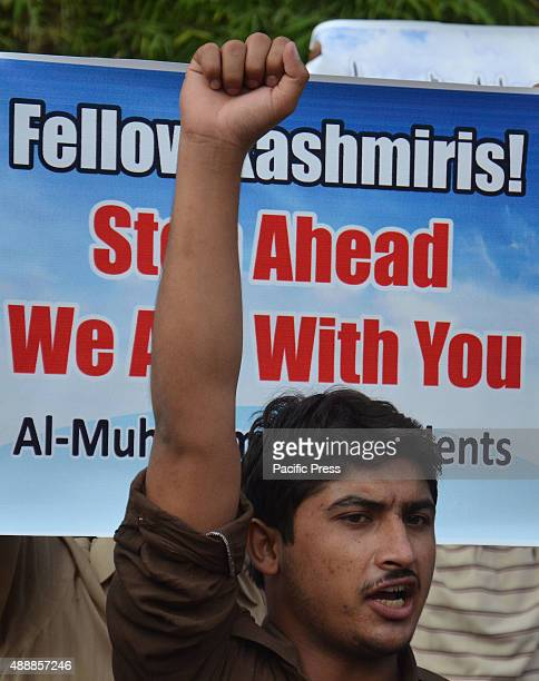 Pakistani student raises his fist during a protest Pakistani students from al Muhammadia Pakistan protest against Indian aggression to Kashmiri...