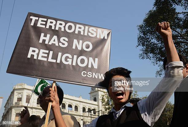 Pakistani student shouts and brings placard during a rally to pay tribute to the victims of the Peshawar school massacre of December 16 the deadliest...