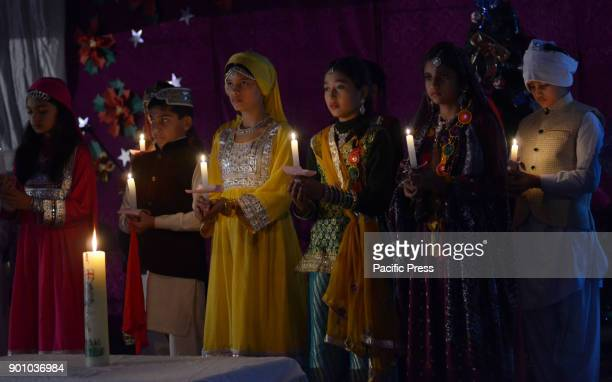 Pakistani students and citizen from different walk hold placards participate in candlelight vigil in memory of Army Public School Peshawar massacres...