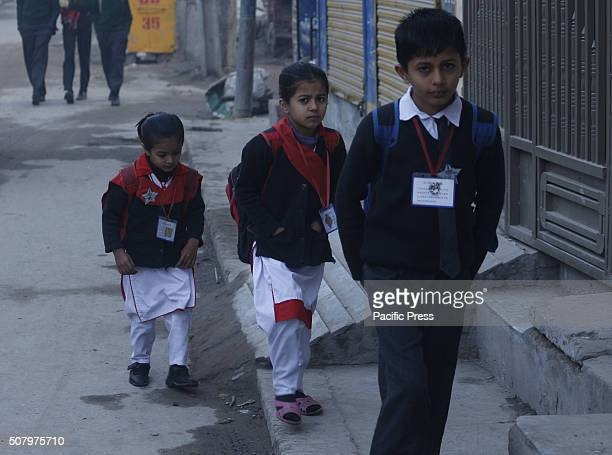 Pakistani Students arrive at a school Most of the government and private schools in Pakistan's Punjab province reopened after a shutdown for six days...