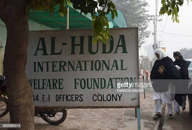 Pakistani students arrive at Al-Huda Institute, one of the most high-profile female seminaries , in Multan on December 8 where female US shooter...