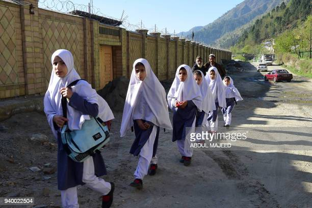 Pakistani students arrive at the Khpal Kor Model School which was built with Malala Yousafzai's Nobel prize money in Malala's home district of...
