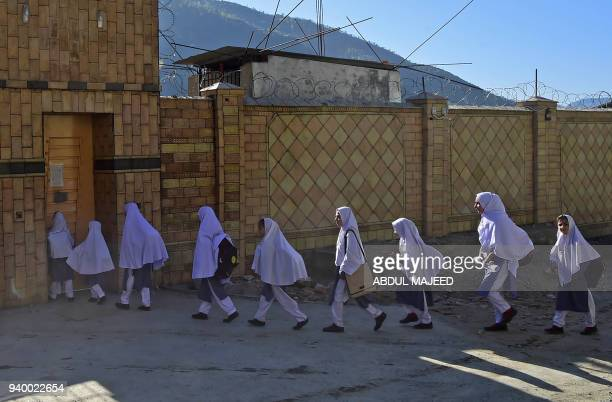 TOPSHOT Pakistani students arrive at the Khpal Kor Model School which was built with Malala Yousafzai's Nobel prize money in Malala's home district...
