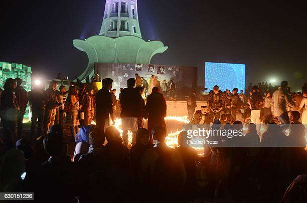 Pakistani students from different colleges and universities light candles and release lanterns in the sky in front of historical greater iqbal park...