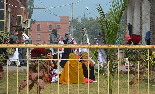 Pakistani students gather at Bahauddin Zakariya University in Multan on December 7 where female US shooter Tashfeen Malik studied The woman who with..