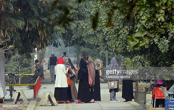 Pakistani students gather at Bahauddin Zakariya University in Multan on December 7 where female US shooter Tashfeen Malik studied The woman who with...