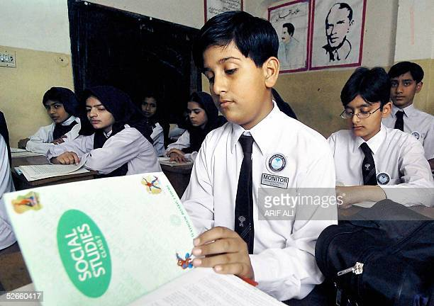 WITH SASIALIFESTYLEEDUCATIONHISTORYTEXTBOOKS Pakistani students go through their daily lessons at a classroom of a school in Lahore 20 April 2005 The...