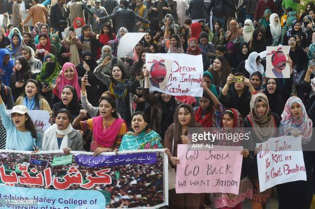 TOPSHOT Pakistani students hold placards with the image of Abhinandan Varthaman the Indian Air Force pilot captured by Pakistan authorities in...