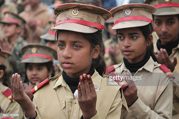 Pakistani students in army uniform attend the protest against the attack of Taliban gunmen in an Army Public School in Peshawar at Lahore The...
