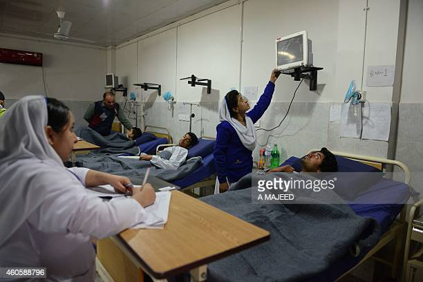 Pakistani students in beds at a hospital a day after an attack by Taliban militants at an armyrun school in Peshawar on December 17 2014 Pakistan...