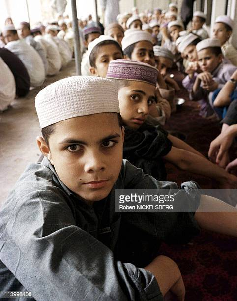 Pakistani students In Peshawar, Pakistan On August 20, 1998-The Islamic school is suported by funds of Saudia Arabia as well as local donations. Many...