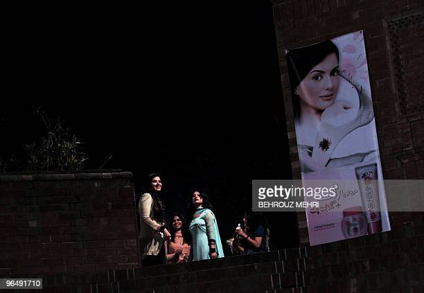 Pakistani students of a women college enter the amphitheatre of the university to attend a Pop concert in Lahore on February 6 2010 AFP PHOTO/BEHROUZ...