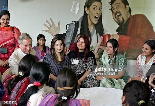 Pakistani students of Fatima Jinnah University listen to Britain's Prince Charles as he speaks during his visit in Rawalpindi 31 October 2006 Charles...