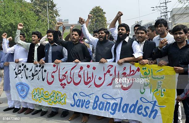 Pakistani students of Islami Jamiat Talba Arbia shout slogans as they mach behind banners in protest in Lahore on March 19 against the death sentence...