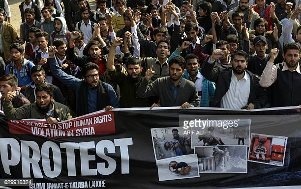 Pakistani students of Islami JamiateTalaba shout slogans during a demonstration in Lahore on December 15 against the ongoing conflict in Syria At...