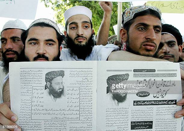 Pakistani students of Islamic seminaries stage a demonstration in Islamabad 06 September 2004 as they hold a magazine showing pictures of Muslim...